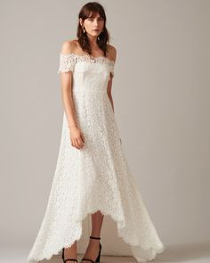 A gorgeous off-the-shoulder dress with a high-low hemline so you won't have to look down to check if you're stepping on excess fabric. 29 Of The Prettiest Wedding Dresses You've Ever Seen How To Dress For A Wedding, Pretty Wedding Dresses, Beautiful Wedding Gowns, Luxury Wedding Dress, Wedding Dress Trends, Wedding Ideas, Wedding Goals, Wedding Shit, Wedding Bouquets