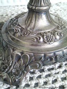 Use whitening toothpaste to remove tarnish from silver.  Cleans without removing all the beautiful patina.