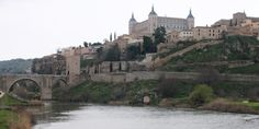 "Solo Travel Destination: Toledo, Spain ""Toledo is even more beautiful the day of their Corpus Christi procession. Tapestries hang over the narrow streets in order to cover the holy monstrance, which contains the presence of God and must always be covered. Herbs are strewn through the streets, and a wonderful aroma fills the air."""