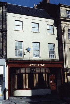 https://flic.kr/p/7ekM1E | 064774:Adelaide Newcastle upon Tyne Harle W. c.1985 | Type : Photograph Medium : Print-colour Description : A photograph of the Adelaide pub taken c. 1985.  The frontage of the building is shown.  Buildings adjoin the Adelaide on both sides.Hotels and Restaurants Collection : Local Studies Printed Copy : If you would like a printed copy of this image please contact Newcastle Libraries www.newcastle.gov.uk/tlt quoting Accession Number : 064774