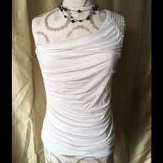 One Shoulder Top With Pearls What a cute one shoulder top this is. I bought this for my daughter and I don't think she ever wore it. Still looks new to me. Off white with the left should adorned with pearls. Can be dressed up or down. Tag says Body C brand but I am not sure that it's Body Con? BodyC Tops Blouses