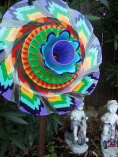 Garden Art - Yard Art - Glass Plate Flower - Suncatcher - Lawn Ornament - Garden Decor - Hand Painted in a Rainbow of Color. $50.00, via Etsy.