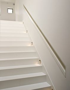 Michaelis Boyd Associates —stair railing detail recessed into wall.