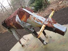 Comprised largely of trash cans and mailboxes with a conduit and wire tail, the scrap metal bull grazes peacefully along the side of Greenspring Station