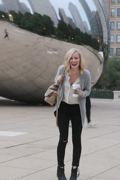 A gray cardigan over a white blouse and skinny black pants. Plus black boots! Love this look for fall fashion.
