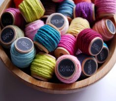 yarn, I love yarn LOL.  This would be cute idea to display scraps on wooden spools for a craft room