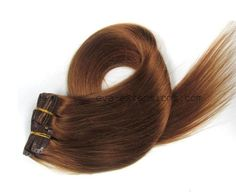 Nouvelle couleur: chocolat clair. Extensions de cheveux qualité remy 40cm de long. Kit de 7 bandes lisses naturelles.