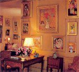 """Greta Gatbo's New York apartment.  Garbo was passionate about color. She would frequently proclaim, """"Color makes a room sing."""" The apartment was resplendent with flowers, both real and re-created, since her collection was filled with floral motifs and images that encapsulated innocence.  There were many truly exceptional works in Garbo's collection–paintings of flowers, clowns, children, funny little dogs and festive people. To her, each had its own story, its own life. Her art provided a…"""