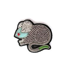 Macon et Lesquoy  Embroidered Mouse Brooch : These small hand-embroidered cannetille pins take inspiration from the precision and quality of military embroideries. A small but precious object, chic, fun, off-the-wall, sometimes colored or articulated... Treat yourself!