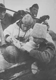 Eastern Front: German officer consults map along with Romanian lieutenant sporting the trademark Astrakhan woolly cap of the Romanian army. The Romanians were poorly led and equipped and their staying power was minimal. They suffered terrible losses in Russia.