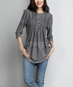 91e3ab28f17 A subtle pattern enlivens this comfy tunic cut with a face-framing notch  neck design