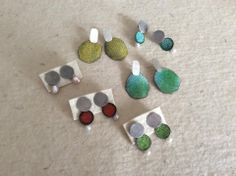 Montserrat Lacomba. Earrings. Silver, copper, enamel and pearls