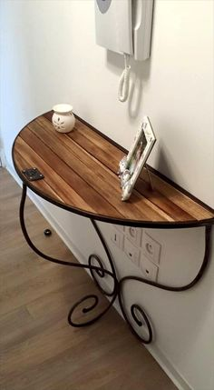Pallet + Old Metal Scroll Base Semi Circular Console - 300+ Pallet Ideas and Easy Pallet Projects You Can Try