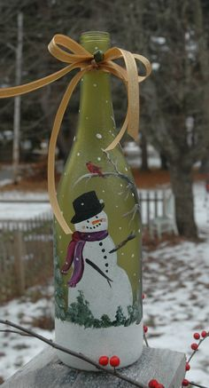 Hand painted wine bottle with fat little snowman - with a cardinal in a tree.  Tied off with some sparkly ribbon and finished off with a little vintage looking jingle ball.  The whole bottle is sparkly, too, had to see in pics and it comes with lights inside, too!