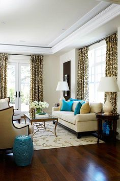 We love this living room! The pop of turquoise makes the room. www.SeaCoastRealty.com #livingroom #realestate