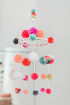 This colorful coral nursery totally strikes a cord with our personal style. The bright palette combined with bohemian nursery accents is fresh, modern, and fun! Flamingo Nursery, Coral Nursery, Baby Nursery Diy, Diy Baby, Nursery Room, Nursery Ideas, Nursery Pom Poms, Nursery Mobiles, Baby Mobiles