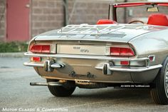 tenwheel.com imgs a b o t q 1971_fiat_850_spider__and_charismatic__wire_wheels_and_luggage_rack_2_lgw.jpg