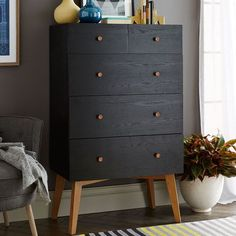 Turn your MALM IKEA dresser into this West Elm Mid Century Mod piece. Tall Storage 5-Drawer Dresser - Black | West Elm