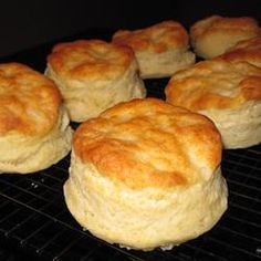 "Fluffy Biscuits: 2 c flour, 4 t baking powder, 3 t sugar, 1/2 t salt,1/2 c shortening,1 egg, 2/3 c milk. Combine flour, BP, sugar & salt. Cut in shortening til resembles coarse crumbs. Beat egg with milk; stir into dry ingredients just until moistened. On floured surface knead 20 times. Roll to 3/4"" thick; cut with floured 2-1/2"" biscuit cutter. Place on greased pan. Bake at 450* for 8-10"""