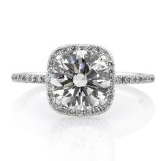 Beautiful brilliant cut diamond with a diamond halo :D So beautiful!! I wish!!