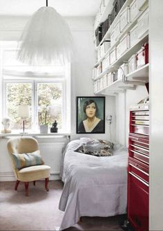 Eclectic and imaginative storage | High shelves & boxes, tool cabinet (great for accessories!), shelf over radiator @ window