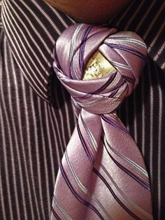 One of the earlier knots I learned to make that helped me fall in love with ties: a Penrose Knot with a nickel in it.