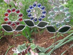 Set of 3 flower garden stakes. Stained glass sun catchers. They grow no matter where you plant them.