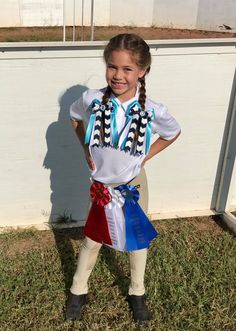 A happy equestrian girl, wearing Bowdangles Horse Show Bows, and all her pretty ribbons from the horse show.