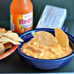 Buffalo Chicken Dip-     2 8-oz packages cream cheese, softened  2 12-oz cans of chunk chicken  1 cup ranch dressing  1 package shredded cheddar cheese (about 2 cups)  Frank's Red Hot Sauce (do NOT use Tabasco!)