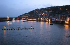Mousehole harbour with Christmas lights, Cornwall, England