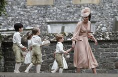 The 33-year-old beamed with happiness as she displayed her famous figure in the fitted guipure lace gown by the British couturier, whose fans include Abbey Clancy and Kendall Jenner. Pictured, Kate with George and Charlotte