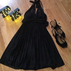 Black sparkle mini dress Black sparkle dress, tie around the neck worn 1 time. Great for school dances or wedding Speechless Dresses Mini
