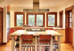 Family Kitchen craftsman kitchen | Note: Range in island, hood over island, light counter tops.