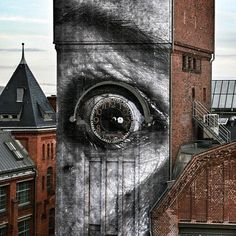 """""""JR has been busy in Germany where he completed several new pieces on the streets of Berlin."""" Wow!!"""