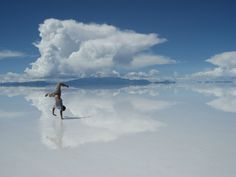 See your reflection in the salt flats of Salar de Uyuni in Bolivia. When it rains, the water makes the place look like a giant mirror.
