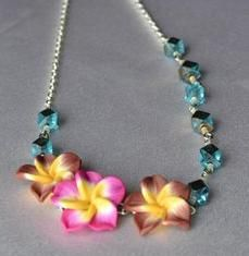 You can buy this new listing on URCrafti! Luau Hawiian Assymetrical Necklace Aqua and Gold Beads Brown and Pink Clay Plumeria
