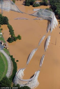 A Six Flags of Georgia roller coaster rises out of the flood waters of the Chattahoochee River in Atlanta. Widespread flooding hit the Atlanta area after more than 18 inches of rain fell in a period. Abandoned Theme Parks, Abandoned Amusement Parks, Amusement Park Rides, Natural Phenomena, Natural Disasters, Abandoned Buildings, Abandoned Places, Wild Weather, Texas Weather