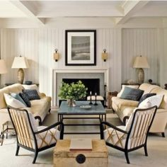 This soothing and symmetrical living room is a fine example of restraint and balance!
