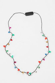 Holiday Flashing Light Necklace. Gotta have this.