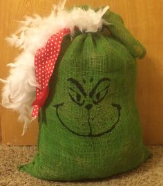 Hey, I found this really awesome Etsy listing at https://www.etsy.com/listing/203542569/the-grinch-burlap-bag-great-porch-sitter