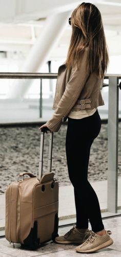 Marianna Hewitt + maximum comfort + travel– black leggings + designer trainers + great option + still looking fashionable on the road.