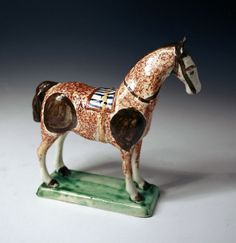 English pottery prattware figure of a standing horse on base