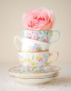 Vintage china teacups - a flower on top