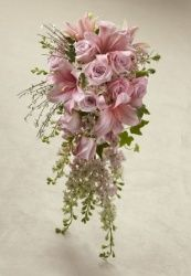 Pink roses, larkspur, and LA Hybrid Lilies are blushingly beautiful accented with white genista and variegated ivy. Tied together at the stems with a silver gray satin ribbon, this bouquet brings a sweet sophistication to your big day. Cascading Wedding Bouquets, Cascade Bouquet, Bride Bouquets, Bridal Flowers, Flower Bouquet Wedding, Floral Bouquets, Floral Wedding, Deco Floral, Flower Delivery