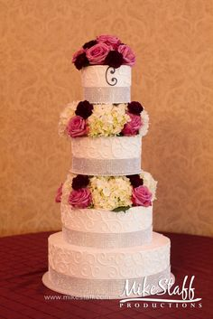 #wedding cake #wedding cake topper #tiered cake #Michigan wedding #Mike Staff Productions #wedding details #wedding photography http://www.mikestaff.com/services/photography #white #flowers #pink #purple
