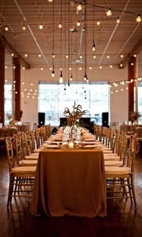 Cafe Lights and Long Head Table at 333 First Avenue Wedding Reception