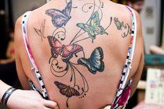 beautiful butterfly upper back tattoo