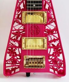 """Guitar """"emailed"""" and made by 3D printer (note the encased flowers and dragon flies). Friggin amazing."""