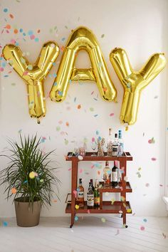 Gold Letter Party Balloons - bridal shower or bachelorette metallic gold decor idea from @urbanoutfitters