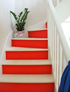 Red and white painted stairs. So inspired to redo my staircase now!